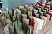 Wet books fanned out to dry