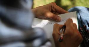 Afghan Woman Writing