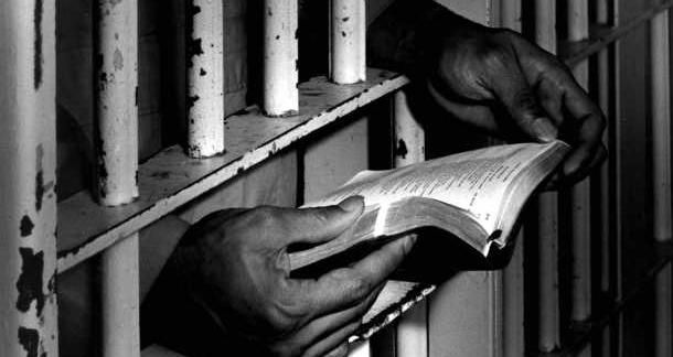 Khmer Rouge victims sell books at former prison